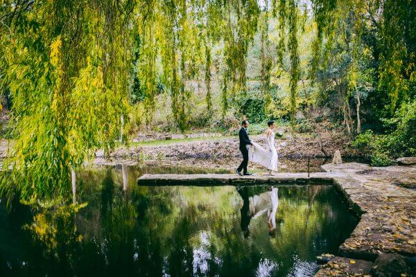 Adelaide Wedding Photographers - Bride and Groom walking near lake Glen Ewin Pulp Shed wedding